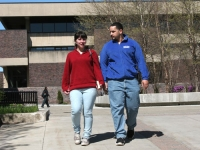 Buffalo State students on campus walking, holding hands